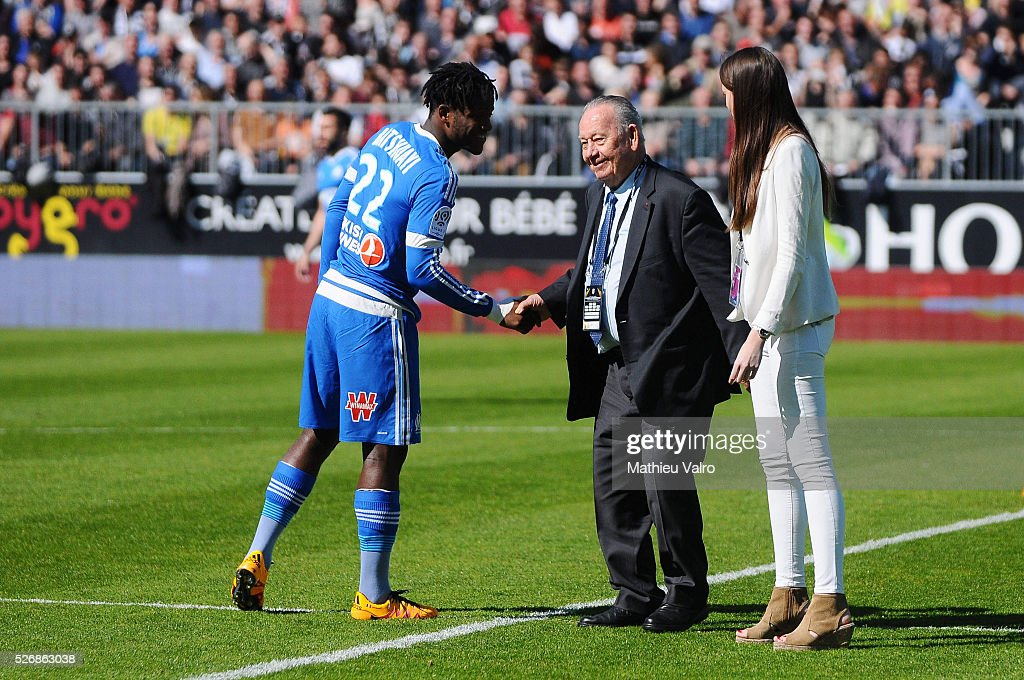 Michy Batshuayi shakes hand to Just Fontaine during the French Ligue 1 match between Angers SCO and Olympique de Marseille on May 1, 2016 in Angers, France.