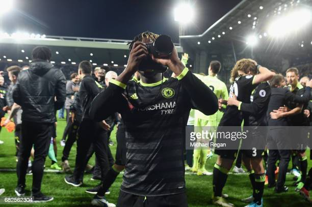 Michy Batshuayi takes pictures as Chelsea celebrate winning the league after the Premier League match between West Bromwich Albion and Chelsea at The...