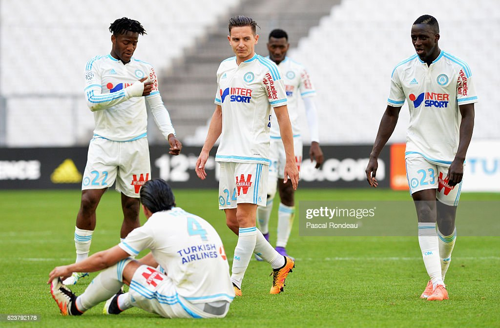 <a gi-track='captionPersonalityLinkClicked' href=/galleries/search?phrase=Michy+Batshuayi&family=editorial&specificpeople=8599446 ng-click='$event.stopPropagation()'>Michy Batshuayi</a>,<a gi-track='captionPersonalityLinkClicked' href=/galleries/search?phrase=Florian+Thauvin&family=editorial&specificpeople=9157453 ng-click='$event.stopPropagation()'>Florian Thauvin</a>,<a gi-track='captionPersonalityLinkClicked' href=/galleries/search?phrase=Benjamin+Mendy&family=editorial&specificpeople=7029850 ng-click='$event.stopPropagation()'>Benjamin Mendy</a>,<a gi-track='captionPersonalityLinkClicked' href=/galleries/search?phrase=Karim+Rekik&family=editorial&specificpeople=7732628 ng-click='$event.stopPropagation()'>Karim Rekik</a> from Marseille during the game between Olympique de Marseille v FC Nantes at Stade Velodrome on April 24, 2016 in Marseille, France.
