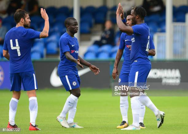 Michy Batshuyai celebrates with team mates N'Golo Kante and Cesc Fabregas after scoring to put his side 31 up during a PreSeason Friendly between...