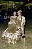 Mick and Bianca Jagger At gold themed 50th Birthday Party of Hon Colin Tennant on Mustique West Indies 22nd November 1976