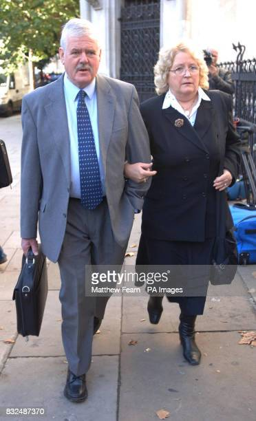 Mick and Pauline Holcroft from Ledbury Herefordshire arrive at the High Court in central London