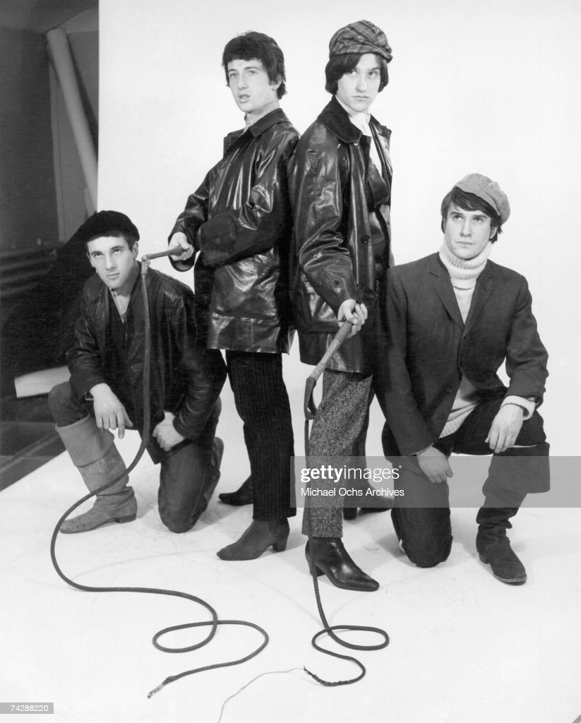 Mick Avory, Peter Quaife, Ray Davies, Dave Davies of the rock group 'The Kinks' pose for a portrait session wearing black leather jackets in the studio in 1965 in London, England.