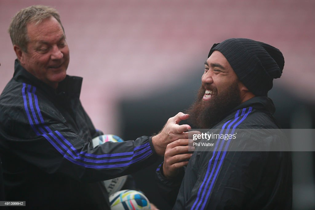 Mick Byrne (L) adjusts the beard of Charlie Faumuina of the All Blacks (R) during a New Zealand All Blacks training session at Mowden Park on October 5, 2015 in Darlington, United Kingdom.
