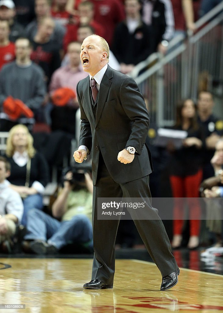Mick Cronin the head coach of the Cincinnati Bearcats gives his team instructions during the game against the Louisville Cardinals at KFC YUM! Center on March 4, 2013 in Louisville, Kentucky.