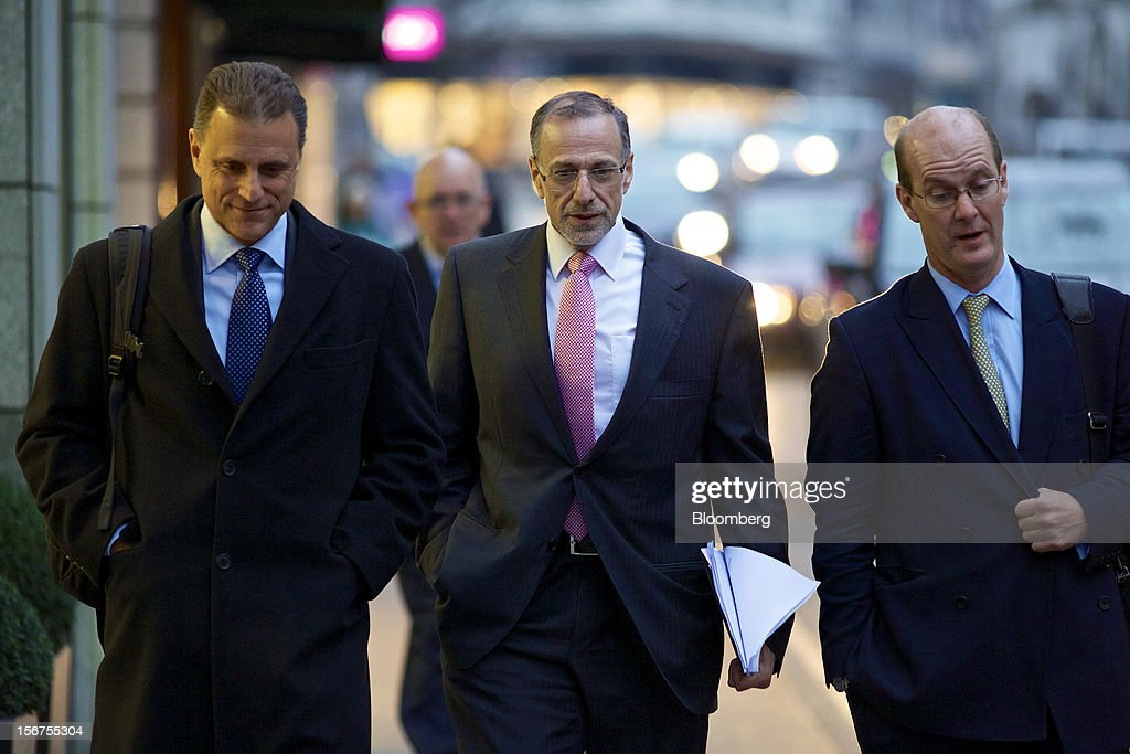 Mick Davis, chief executive officer of Xstrata Plc, center, leaves following a shareholder's meeting in Zug, Switzerland, on Tuesday, Nov. 20, 2012. Glencore International Plc's $31 billion takeover of Xstrata Plc was approved by investors, leaving clearance by regulators in Europe and China as the remaining hurdles for this year's biggest deal. Photographer: Gianluca Colla/Bloomberg via Getty Images