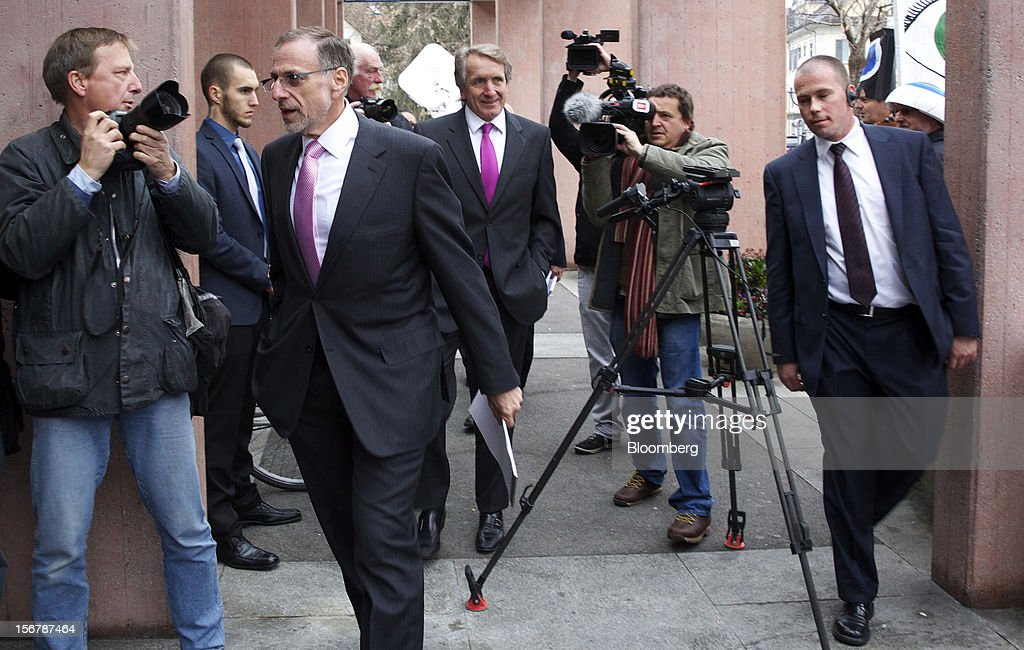 <a gi-track='captionPersonalityLinkClicked' href=/galleries/search?phrase=Mick+Davis&family=editorial&specificpeople=240575 ng-click='$event.stopPropagation()'>Mick Davis</a>, chief executive officer of Xstrata Plc, center left, and Trevor Reid, chief financial officer of Xstrata Plc, center, arrive for a shareholder's meeting in Zug, Switzerland, on Tuesday, Nov. 20, 2012. Xstrata shareholders voted to approve this year's biggest takeover, combining the Zug, Switzerland-based company's coal, copper, nickel and zinc mining assets with Glencore's cotton-to-crude oil commodities trading empire. Photographer: Gianluca Colla/Bloomberg via Getty Images