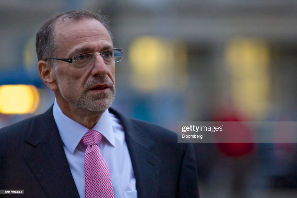 Mick Davis, chief executive officer of Xstrata Plc, leaves following a shareholder's meeting in Zug, Switzerland, on Tuesday, Nov. 20, 2012. Glencore International Plc's $31 billion takeover of Xstrata Plc was approved by investors, leaving clearance by regulators in Europe and China as the remaining hurdles for this year's biggest deal. Photographer: Gianluca Colla/Bloomberg via Getty Images