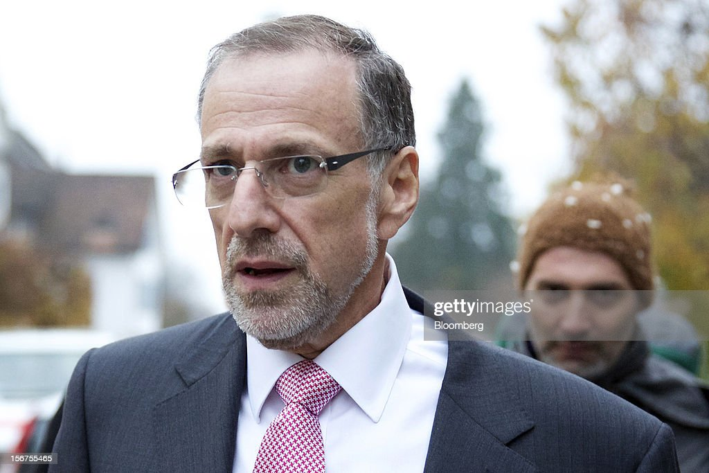 Mick Davis, chief executive officer of Xstrata Plc, left, leaves following a shareholder's meeting in Zug, Switzerland, on Tuesday, Nov. 20, 2012. Glencore International Plc's $31 billion takeover of Xstrata Plc was approved by investors, leaving clearance by regulators in Europe and China as the remaining hurdles for this year's biggest deal. Photographer: Gianluca Colla/Bloomberg via Getty Images