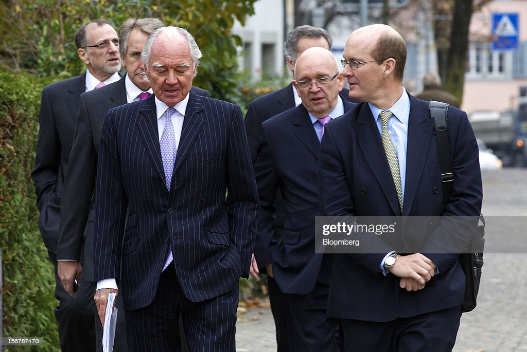 <a gi-track='captionPersonalityLinkClicked' href=/galleries/search?phrase=Mick+Davis&family=editorial&specificpeople=240575 ng-click='$event.stopPropagation()'>Mick Davis</a>, chief executive officer of Xstrata Plc, left, Trevor Reid, chief financial officer of Xstrata Plc, second left, and John Bond, chairman of Xstrata Plc, third left, arrive with colleagues for a shareholder's meeting in Zug, Switzerland, on Tuesday, Nov. 20, 2012. Xstrata shareholders voted to approve this year's biggest takeover, combining the Zug, Switzerland-based company's coal, copper, nickel and zinc mining assets with Glencore's cotton-to-crude oil commodities trading empire. Photographer: Gianluca Colla/Bloomberg via Getty Images