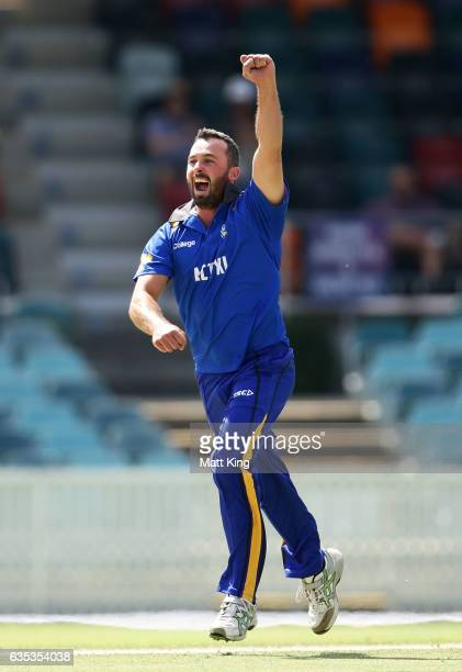 Mick Delaney of ACT celebrates taking the wicket of Dogodo Bau of Papua New Guinea during the T20 warm up match between ACT and Papua New Guinea at...