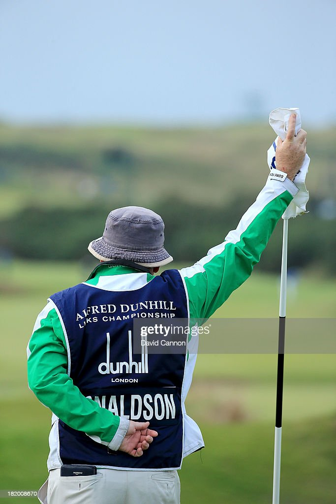 Mick Donaghy who caddies for Jamie donaldson of Wales holding the flag on the 7th hole during the second round of the 2013 Alfred Dunhill Links Championship at the Kingsbarns Golf Links on September 27, 2013 in Kingsbarns, Scotland.