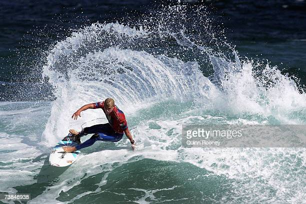 Mick Fanning of Australia carves on the lip of the wave during round three of the Rip Curl Pro on April 10 2007 at Johanna Beach Australia