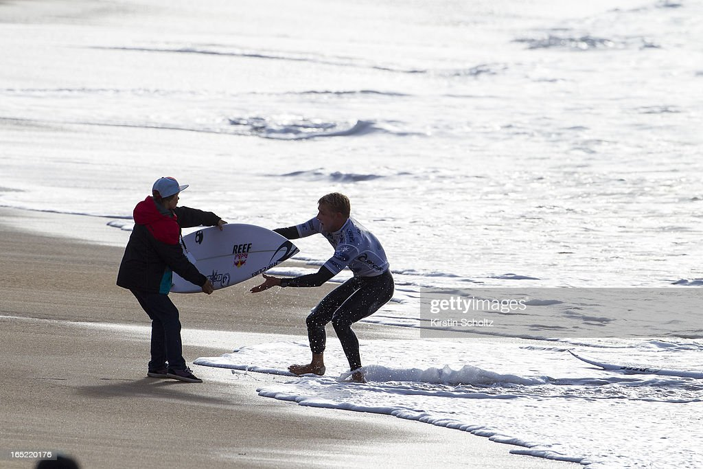 Mick Fanning of Australia comes in for a board change April 2, 2013 in Bells Beach, Australia.