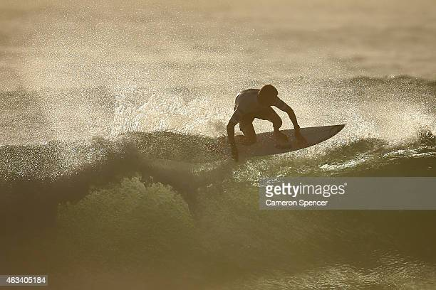 Mick Fanning of Australia competes during the Australian Open of Surfing at Manly Beach on February 14 2015 in Sydney Australia