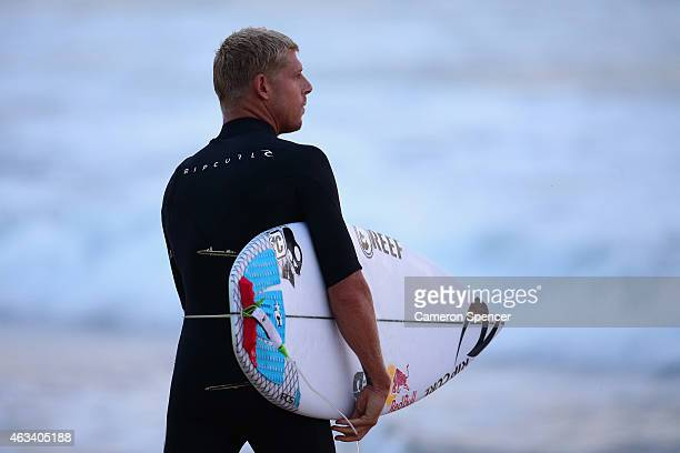 Mick Fanning of Australia looks out at the waves during the Australian Open of Surfing at Manly Beach on February 14 2015 in Sydney Australia
