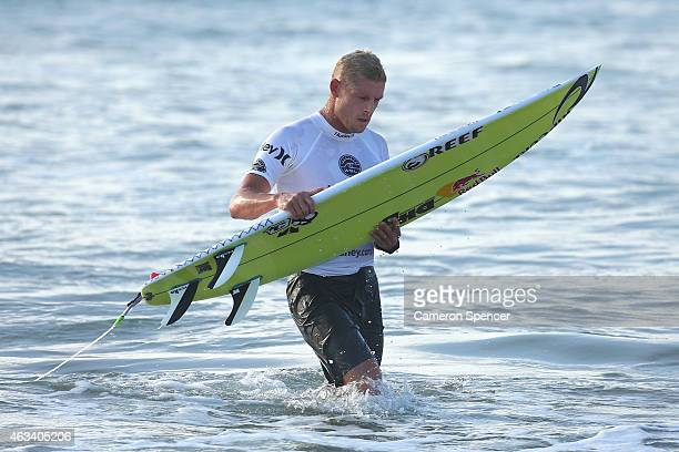 Mick Fanning of Australia returns to shore following his heat during the Australian Open of Surfing at Manly Beach on February 14 2015 in Sydney...