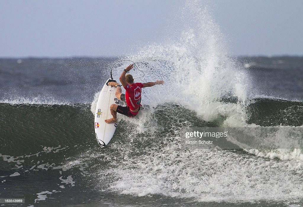 <a gi-track='captionPersonalityLinkClicked' href=/galleries/search?phrase=Mick+Fanning&family=editorial&specificpeople=553784 ng-click='$event.stopPropagation()'>Mick Fanning</a> of Australia surfs into the semifinals during the Quiksilver Pro, on March 12, 2013 in Gold Coast, Australia.
