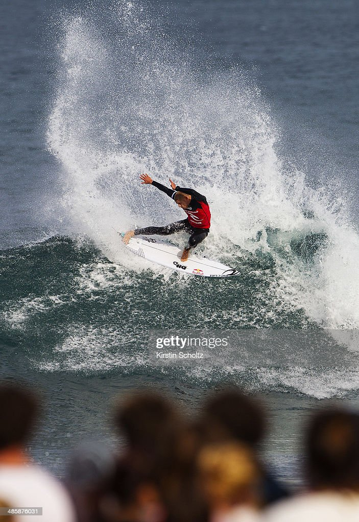 <a gi-track='captionPersonalityLinkClicked' href=/galleries/search?phrase=Mick+Fanning&family=editorial&specificpeople=553784 ng-click='$event.stopPropagation()'>Mick Fanning</a> of Australia surfs to victory during Round 4 at the Rip Curl Pro Bells Beach on April 21, 2014 in Bells Beach, Australia.