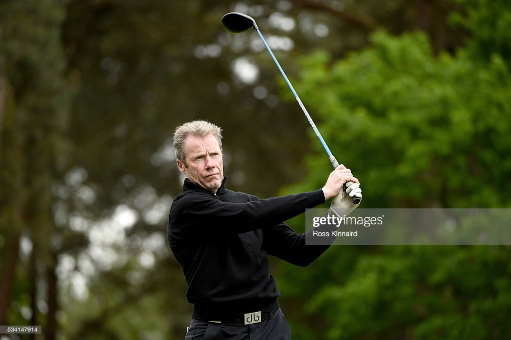 Mick Fitzgerald tees off during the Pro-Am prior to the BMW PGA Championship at Wentworth on May 25, 2016 in Virginia Water, England.