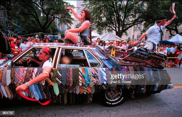 Mick Howley acts as chauffeur for the 'Tie Rod' car as it moves through downtown Houston Texas in the Art Car Parade April 15 2000 More than 250...