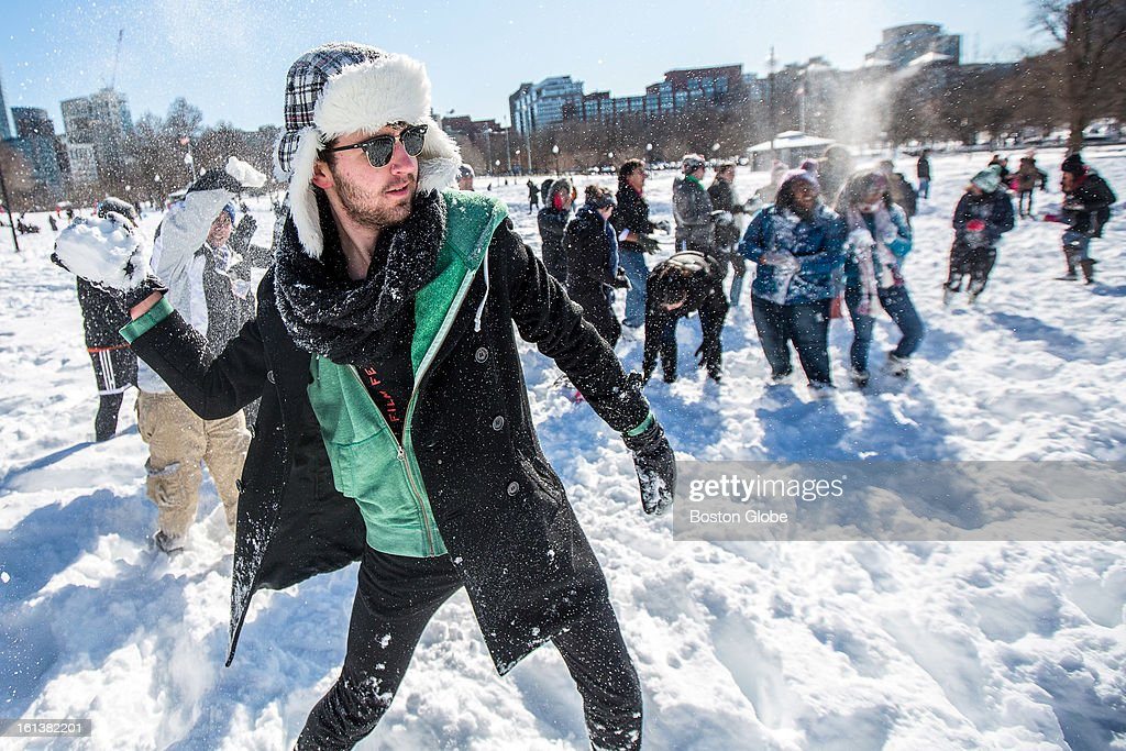 Mick Jacobs, 20, an Emerson student, hurled a snowball at the opposing side as about 50 people participated in a planned snowball fight on Boston Common after a blizzard dropped over two feet of snow in the area, Sunday, Feb. 10, 2013.