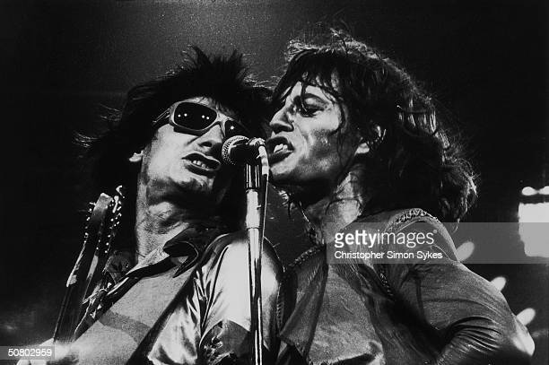 Mick Jagger and guitarist Ron Wood share vocal duties on stage during the Rolling Stones' 1975 Tour of the Americas