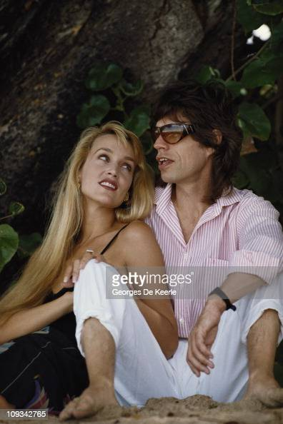 Mick Jagger and Jerry Hall on a beach in the West Indies 18th February 1987
