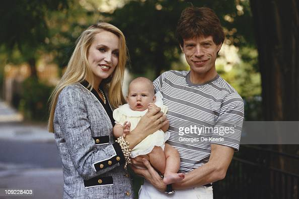 Mick Jagger and Jerry Hall with one of their children circa 1990