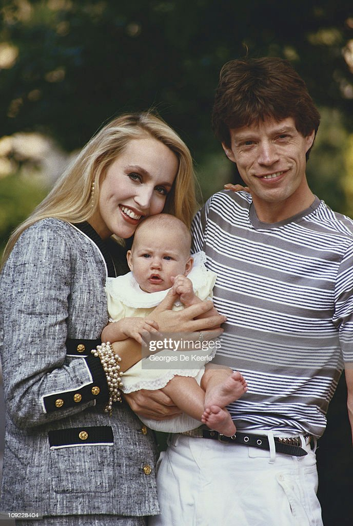 Mick Jagger and Jerry Hall with one of their children, circa 1990.