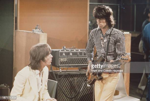 Mick Jagger and Keith Richards from The Rolling Stones record the track 'Sympathy for the Devil' at Olympic Studios in Barnes London 10th June 1968
