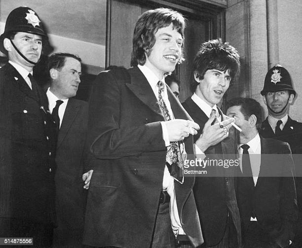 Mick Jagger and Keith Richards leave court after being charged with drug possession