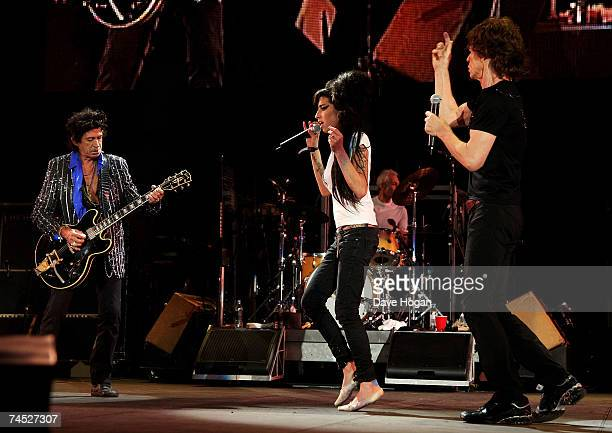 Mick Jagger and Keith Richards of the Rolling Stones and Amy Winehouse perform on stage on the final day of the Isle of Wight Festival 2007 in...
