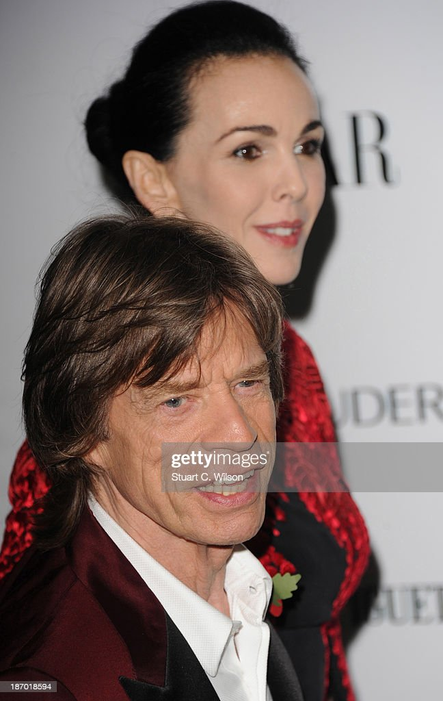 Mick Jagger and L'Wren Scott arrive for the Harpers Bazaar Women Of The Year Awards at Claridges Hotel on November 05, 2013 in London, England.