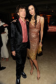 Mick Jagger and L'Wren Scott attend the 2011 Vanity Fair Oscar Party Hosted by Graydon Carter at the Sunset Tower Hotel on February 27 2011 in West...