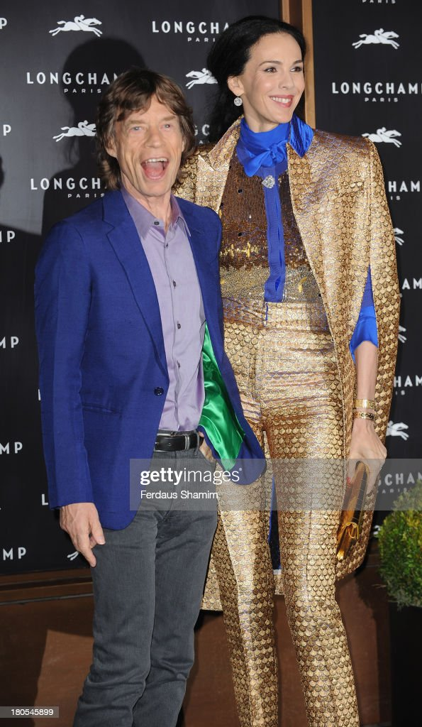 Mick Jagger and L'Wren Scott attend the grand opening party of Longchamp Regent Street on September 14, 2013 in London, England.