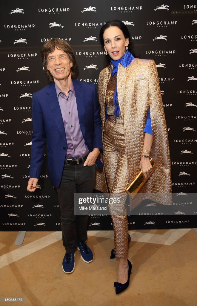<a gi-track='captionPersonalityLinkClicked' href=/galleries/search?phrase=Mick+Jagger&family=editorial&specificpeople=201786 ng-click='$event.stopPropagation()'>Mick Jagger</a> and <a gi-track='captionPersonalityLinkClicked' href=/galleries/search?phrase=L%27Wren+Scott+-+Fashion+Designer&family=editorial&specificpeople=566708 ng-click='$event.stopPropagation()'>L'Wren Scott</a> attend the grand opening party of Longchamp Regent Streetat Longchamp on September 14, 2013 in London, England.
