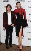 Mick Jagger and L'Wren Scott attend the Harpers Bazaar Women of the Year awards at Claridge's Hotel on November 5 2013 in London England