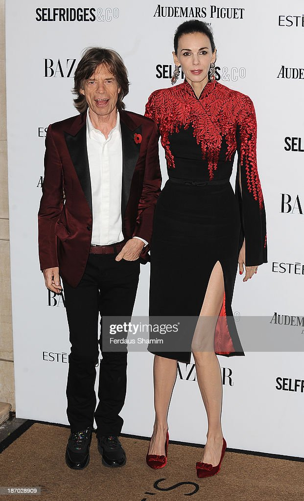 Mick Jagger and L'Wren Scott attend the Harpers Bazaar Women of the Year awards at Claridge's Hotel on November 5, 2013 in London, England.
