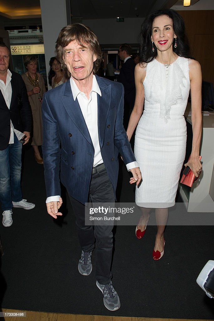 <a gi-track='captionPersonalityLinkClicked' href=/galleries/search?phrase=Mick+Jagger&family=editorial&specificpeople=201786 ng-click='$event.stopPropagation()'>Mick Jagger</a> and <a gi-track='captionPersonalityLinkClicked' href=/galleries/search?phrase=L%27Wren+Scott+-+Fashion+Designer&family=editorial&specificpeople=566708 ng-click='$event.stopPropagation()'>L'Wren Scott</a> attend the private view of The Suzy Menkes Collection: In My Fashion at Christie's on July 11, 2013 in London, England.