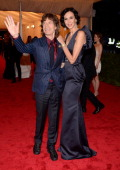 Mick Jagger and L'Wren Scott attend the 'Schiaparelli And Prada Impossible Conversations' Costume Institute Gala at the Metropolitan Museum of Art on...