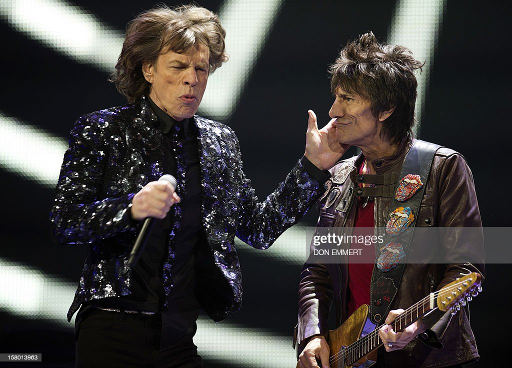 Mick Jagger (L) and Ron Wood of the Rolling Stones perform during 'The Stones-50 and Counting' tour December 8, 2012 at the Barclays Center in Brooklyn, NY. The band performed it's first American concert celebrating it's 50th anniversary. AFP PHOTO/DON EMMERT L to R) , Keith Richards, Charlie Watts and Mick Jagger.