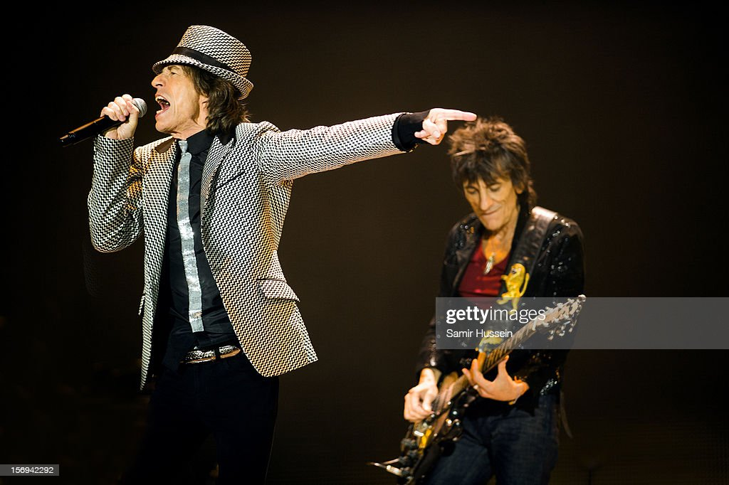 Mick Jagger and Ronnie Wood of The Rolling Stones perform live on stage at the first of their 50th Anniversary concerts at the O2 Arena on November 25, 2012 in London, England.