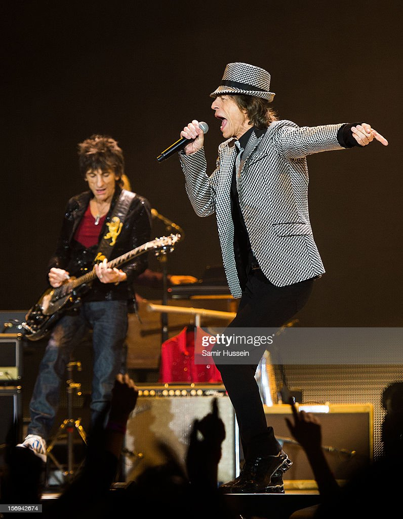 <a gi-track='captionPersonalityLinkClicked' href=/galleries/search?phrase=Mick+Jagger&family=editorial&specificpeople=201786 ng-click='$event.stopPropagation()'>Mick Jagger</a> and Ronnie Wood of The Rolling Stones perform live on stage at the first of their 50th Anniversary concerts at the O2 Arena on November 25, 2012 in London, England.