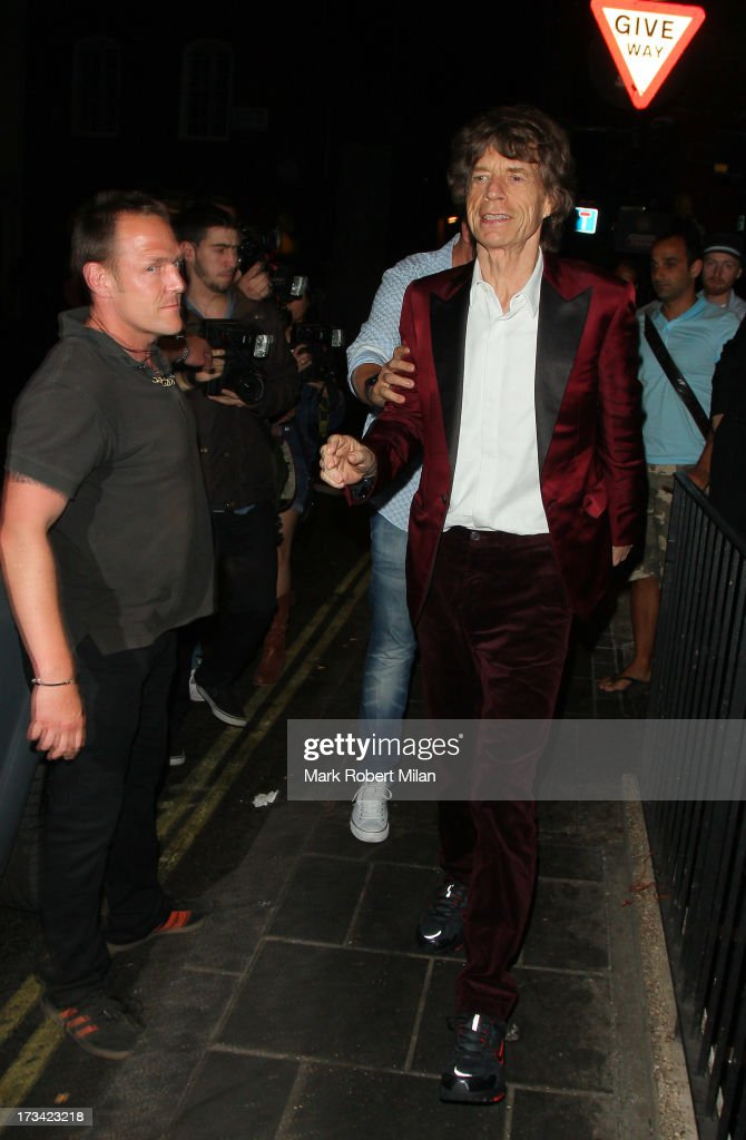 <a gi-track='captionPersonalityLinkClicked' href=/galleries/search?phrase=Mick+Jagger&family=editorial&specificpeople=201786 ng-click='$event.stopPropagation()'>Mick Jagger</a> at Loulou's club on July 13, 2013 in London, England.