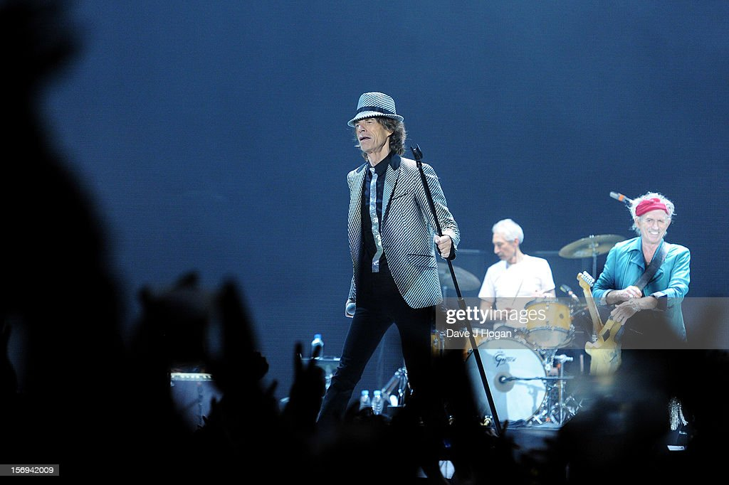 Mick Jagger, Charlie Watts and Keith Richards of the Rolling Stones perform at 02 Arena on November 25, 2012 in London, England.