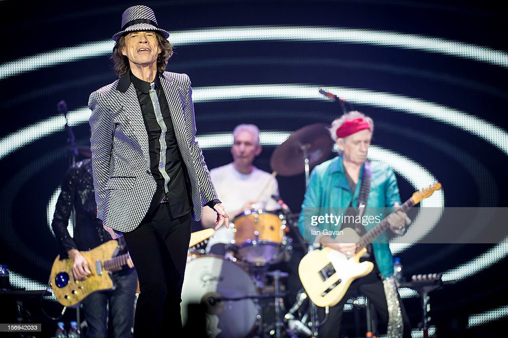 Mick Jagger, Charlie Watts and Keith Richards of The Rolling Stones perform live at 02 Arena on November 25, 2012 in London, England.