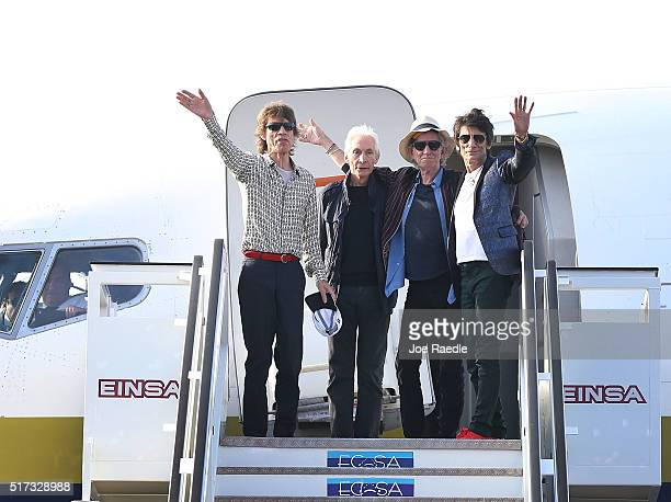 Mick Jagger Charlie Watts Keith Richards and Ronnie Wood of the Rolling Stones wave as they exit their plane after landing at the Jose Marti...