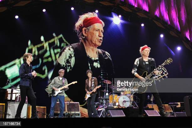 Mick Jagger Eric Clapton Ronnie Wood Charlie Watts and Keith Richards of The Rolling Stones perfom at The O2 Arena on November 29 2012 in London...