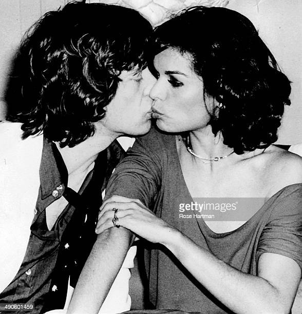 Mick Jagger gives Bianca a kiss during Bianca's birthday party at Studio 54 New York New York 1977